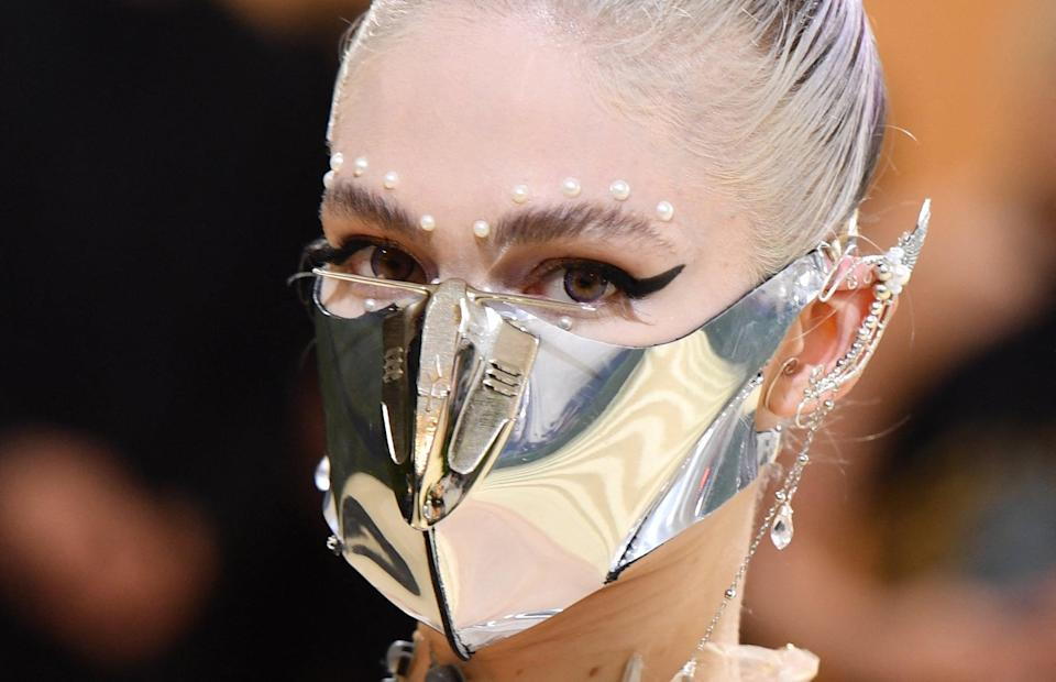 <p>Trust Grimes to take any theme and fully run with it. The 2021 Met Gala was no different <em>but</em> this year her makeup was something you might actually be able to recreate at home. To show off that epic mirrored face mask, bold black winged liner was the focal point of her makeup. To soften the whole look up and add some extra detailing, pearl gems were added along the top of her eyebrows, as well as underneath her lower lash line.</p>