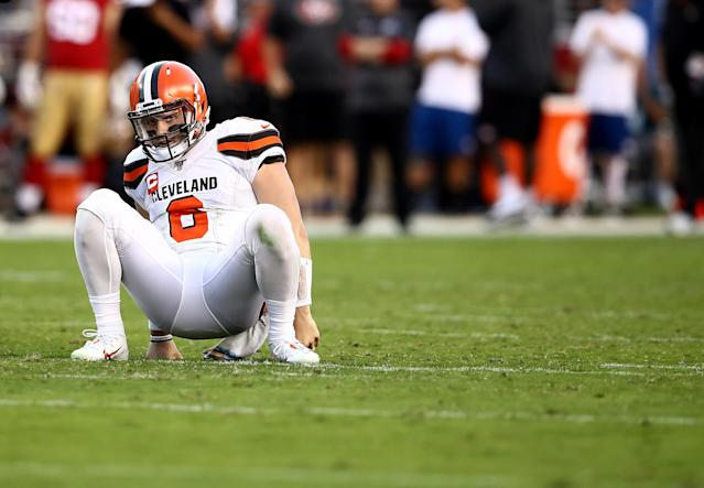Quarterback Baker Mayfield of the Cleveland Browns gets up after being hit by the San Francisco 49ers defense. (Getty Images)
