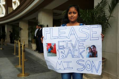 Elsa Ortiz, whose son David Tobar is at a shelter in Houston after being separated, protests outside the hotel where U.S. Homeland Security Secretary Kirstjen Nielsen is holding a meeting with foreign ministers, in Guatemala City