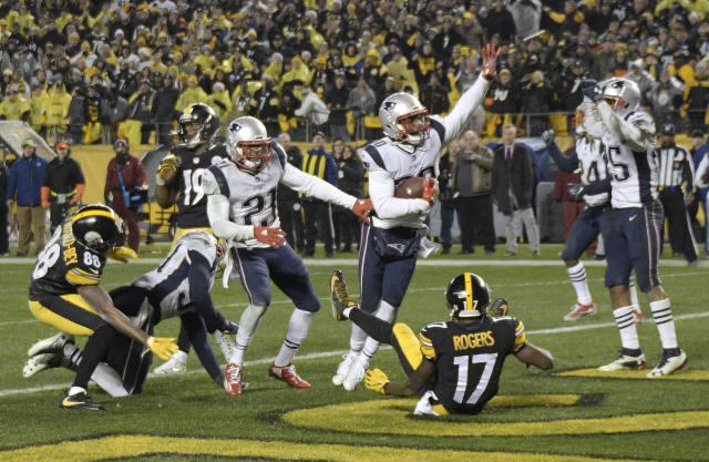 New England Patriots safety Duron Harmon, center, celebrates his game-sealing end zone interception of the Pittsburgh Steelers' Ben Roethlisberger on Sunday. (AP)