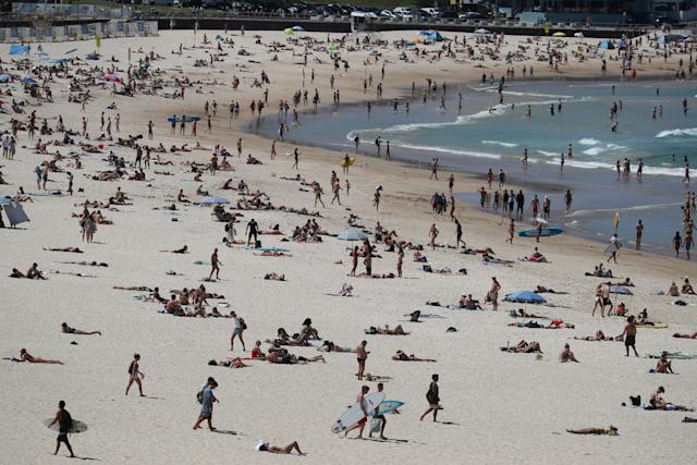 Beachgoers turned out in force at Sydney's Bondi Beach despite growing concerns about the spread of coronavirus. (Picture: REUTERS/Loren Elliott)