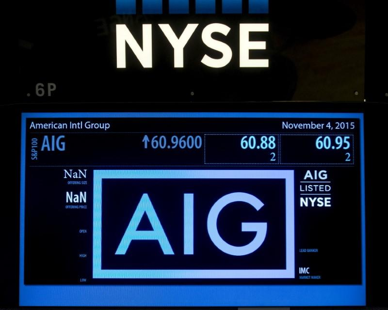 The ticker information for insurance company American International Group Inc., (AIG) is displayed on a screen above the post where it is traded on the floor of the New York Stock Exchange