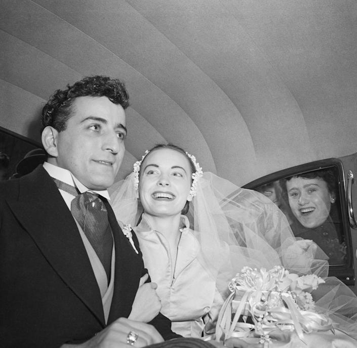 <p>Tony Bennett and his bride, Patricia Beech, leave St. Patrick's Cathedral after their wedding. Tony and Patricia were married until 1971 and she was his first of three wives. </p>