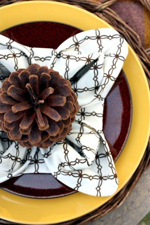 napkin folded in to pinecone shape accented with yellow