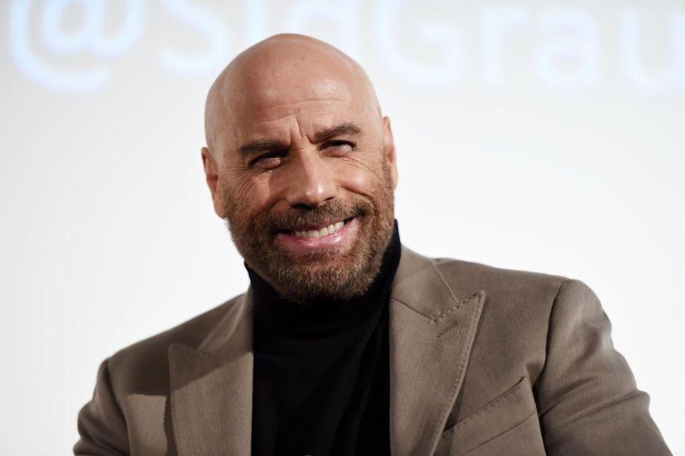 """<p>Now: Travolta has had a<a href=""""https://www.imdb.com/name/nm0000237/"""" rel=""""nofollow noopener"""" target=""""_blank"""" data-ylk=""""slk:45-year career"""" class=""""link rapid-noclick-resp""""> 45-year career</a> with countless hits, like Saturday Night Fever, Grease, Pulp Fiction, and even Hairspray. With countless roles showcasing his dancing skill and trademark cleft chin, Travolta is one of the most recognized actors in Hollywood.</p>"""