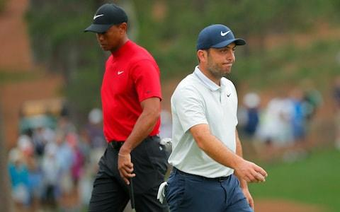 <span>Woods took advantage of Francesco Molinari (R) capitulating on the back nine</span> <span>Credit: REUTERS </span>