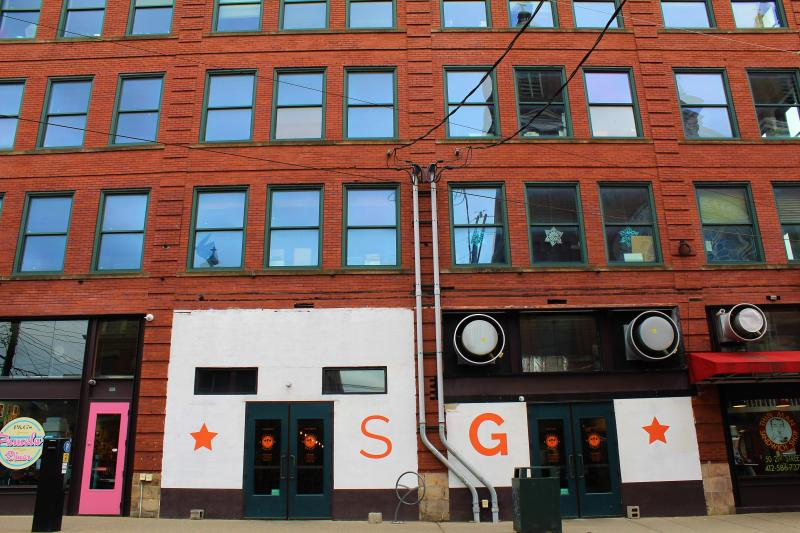 This undated photo provided by the Galley Group shows the exterior of Smallman Galley in Pittsburgh's Strip District, once an industrial neighborhood and now home to robotics startups and Argo AI.  A mix of homegrown chefs and transplants from other cities have been opening risk-taking and award-winning restaurants in Pittsburgh, offering creative spins on American food and authentic takes on cuisines like Venezuelan and Vietnamese that would have been hard to find less than a decade ago. (Galley Group via AP)