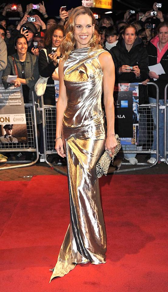 """Two-time Oscar winner Hilary Swank -- who tends to falter in the fashion department -- wowed the crowd in a sleek and chic Donna Karan Resort 2011 gown upon arriving at the London premiere of her new drama, """"Conviction."""" Jon Furniss/<a href=""""http://www.wireimage.com"""" target=""""new"""">WireImage.com</a> - October 15, 2010"""