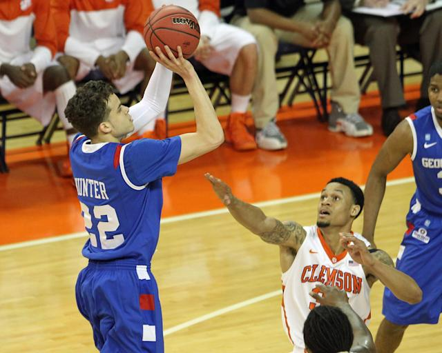 Georgia State's R.J. Hunter. left, attempts a shot over Clemson's K.J. McDaniels in the first half of their NCAA college basketball National Invitational Tournament game at Littlejohn Coliseum in Clemson, S.C. on Tuesday March 18, 2014. (AP Photo/Anderson Independent-Mail, Mark Crammer)