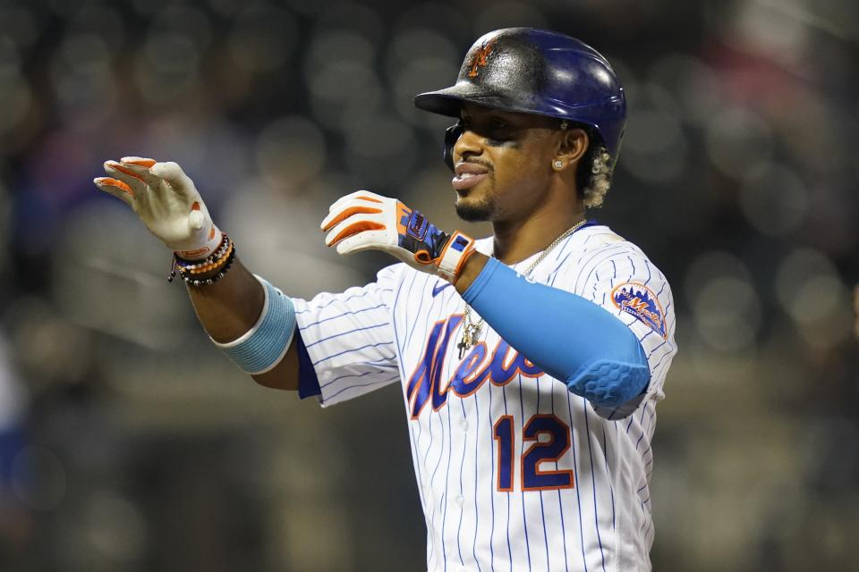New York Mets' Francisco Lindor (12) gestures to his teammates after hitting a single during the seventh inning of a baseball game against the Philadelphia Phillies Wednesday, April 14, 2021, in New York. (AP Photo/Frank Franklin II)