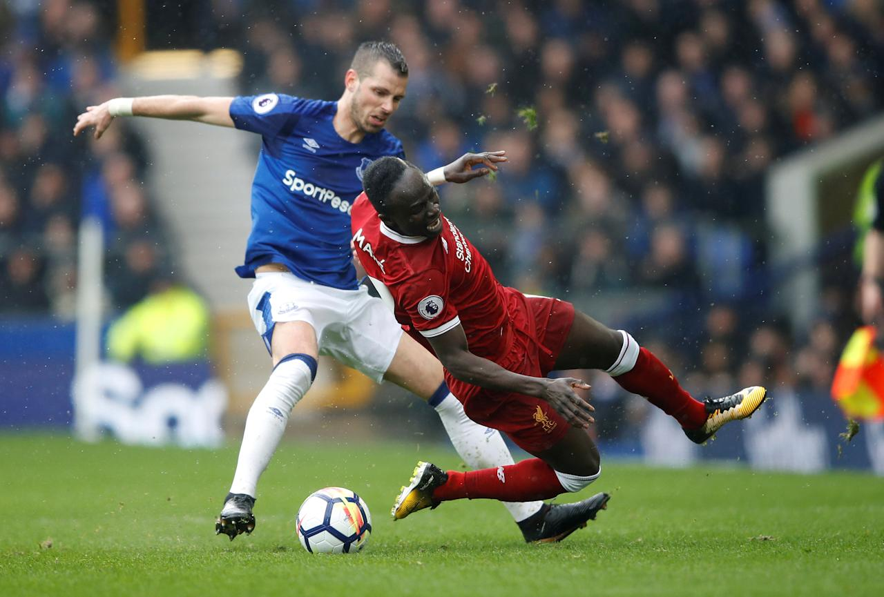 <p>Liverpool's Sadio Mane feels the presence of Everton's Morgan Schneiderlin </p>
