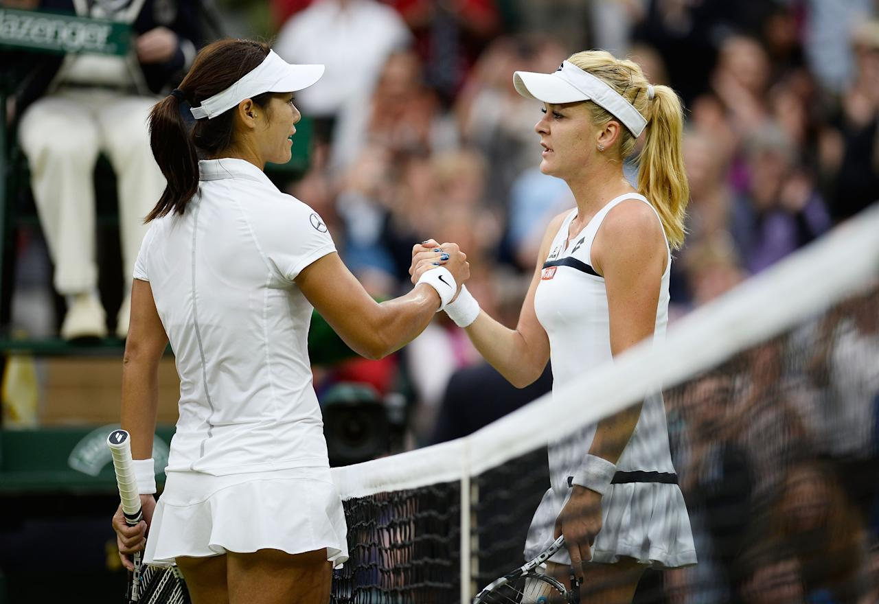 LONDON, ENGLAND - JULY 02: Agnieszka Radwanska of Poland shakes hands at the net with Na Li of China after their Ladies' Singles quarter-final match on day eight of the Wimbledon Lawn Tennis Championships at the All England Lawn Tennis and Croquet Club at Wimbledon on July 2, 2013 in London, England. (Photo by Dennis Grombkowski/Getty Images)