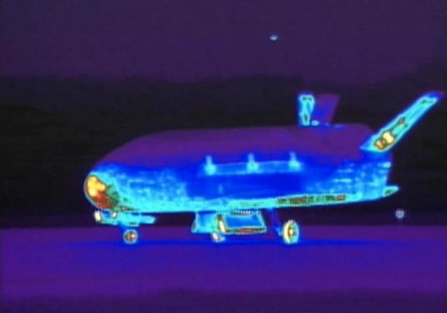 This Saturday, June 16, 2012 image from video made available by the Vandenberg Air Force Base shows an infrared view of the X-37B unmanned spacecraft landing at Vandenberg Air Force Base. The spacecraft, which was launched from Cape Canaveral Air Force Station in Florida in March 2011, conducted in-orbit experiments during the 15-month clandestine mission, officials said. It was the second such autonomous landing at the base. (AP Photo/Vandenberg Air Force Base)