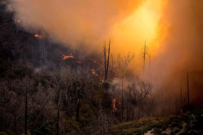 FILE PHOTO: A wildfire burns in the Angeles National Forest during the Bobcat Fire in Los Angeles