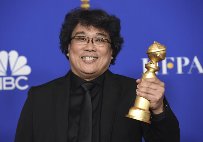 "Director Bong Joon-ho poses in the press room with the award for best foreign language motion picture for ""Parasite"" at the 77th annual Golden Globe Awards at the Beverly Hilton Hotel on Sunday, Jan. 5, 2020, in Beverly Hills, Calif. (AP Photo/Chris Pizzello)"