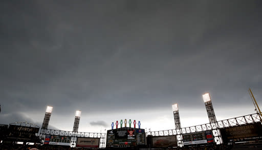 Storm clouds move in over Guaranteed Rate Field during the fourth inning of a baseball game between the Minnesota Twins and the Chicago White Sox, Sunday, June 30, 2019, in Chicago. (AP Photo/Jeff Haynes)