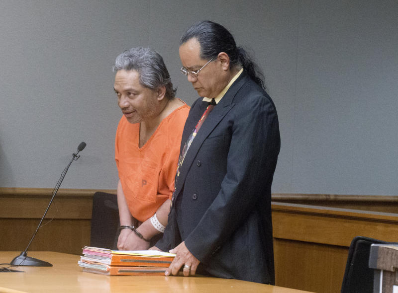 """FILE - In this April 5, 2017 file photo, Peter Kema Sr., left, pleads guilty to manslaughter and first-degree hindering prosecution in the death of his son, Peter Kema Jr., also known as """"Peter Boy,"""" who went missing in 1997, in Hilo Circuit Court in Hilo, Hawaii. The father of the Hawaii boy who went missing 20 years ago has led police to the site where he disposed his son's remains. Kema Sr. is providing information about the location of the boy's body as part of a plea deal reached earlier this month. (Hollyn Johnson/Hawaii Tribune-Herald via AP, Pool, File)"""