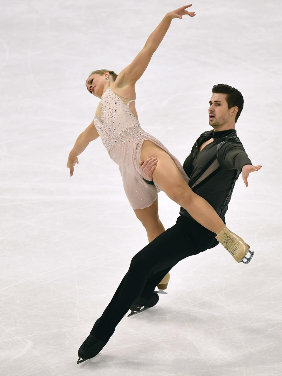 Madison Hubbell and Zachary Donohue of the USA perform during the Ice Dance-Free Dance at the Figure Skating World Championships in Stockholm, Sweden, Saturday, March 27, 2021. (AP Photo/Martin Meissner)