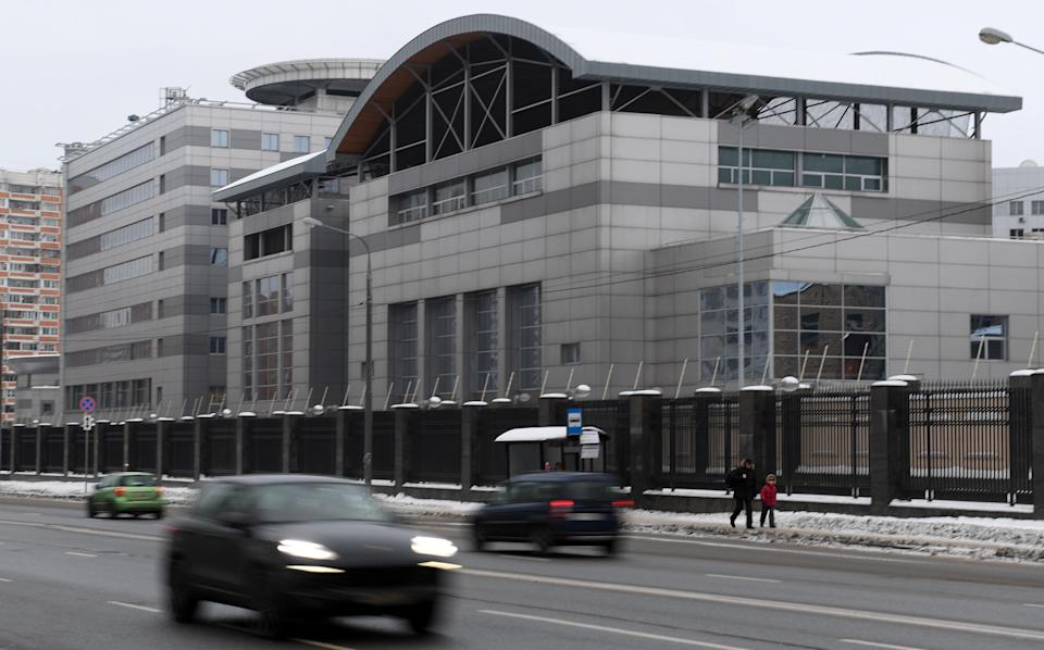 <p>Cars drive past the headquarters of the Russian General Staff's Main Intelligence Department (GRU) in Moscow on December 30, 2016</p> (AFP via Getty Images)
