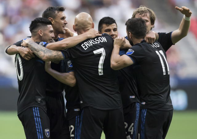 San Jose Earthquakes' Cristian Espinoza, from left to right, Chris Wondolowski, Magnus Eriksson, Nick Lima, Vako Qazaishvili and Florian Jungwirth celebrate Wondolowski's goal against the Vancouver Whitecaps during the first half of an MLS soccer game, Saturday, July 20, 2019 in Vancouver, British Columbia. (Darryl Dyck/The Canadian Press via AP)