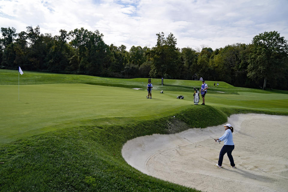 Inbee Park, of South Korea, hits from a sand trap onto the 14th green in the second round of the Cognizant Founders Cup LPGA golf tournament, Friday, Oct. 8, 2021, in West Caldwell, N.J. (AP Photo/John Minchillo)
