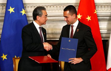 Chinese Foreign Minister Wang Yi and Italian Minister of Labor and Industry Luigi Di Maio shake hands after signing trade agreements at Villa Madama in Rome, Italy March 23, 2019. REUTERS/Yara Nardi