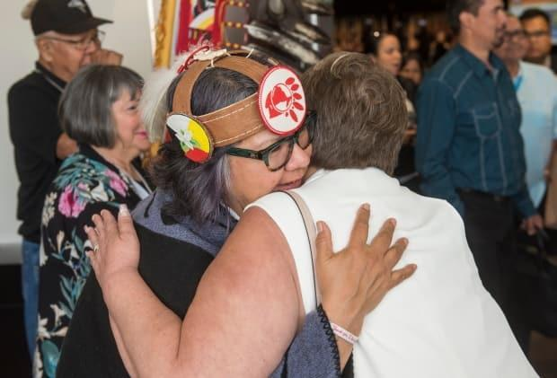Ontario Regional Chief RoseAnne Archibald gets a hug after the closing ceremony of the AFN's Annual General Assembly in Fredericton, N.B., Thursday, July 25, 2019. (Stephen MacGillivray/The Canadian Press - image credit)