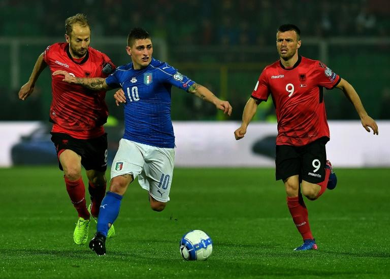 Italy's midfielder Marco Veratti (C) fights for the ball with Albania's defender Naser Aliji (L) and midfielder Ledian Memushaj during the FIFA World Cup 2018 qualification football match March 24, 2017