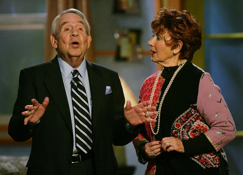 """FILE - In this Dec. 1, 2004 file photo, Tom Bosley, left, and Marion Ross, who played parents on the television show """"Happy Days,"""" speak to attendees of the sixth annual Family Television Awards in Beverly Hills, Calif.  The wife of the late Tom Bosley and a few other actors claim they're owed millions in merchandise rights.  An attorney for the cast members says after filing a $10 million lawsuit earlier this year, the actors received checks for merchandise in the amount of roughly $6,000. (AP Photo/Danny Moloshok, file)"""