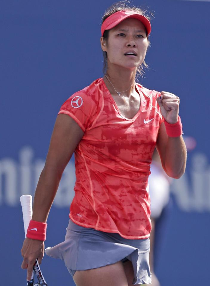 Li Na, of China, reacts after a point against Ekaterina Makarova, of Russia, during the quarterfinals of the 2013 U.S. Open tennis tournament, Tuesday, Sept. 3, 2013, in New York. (AP Photo/Julio Cortez)