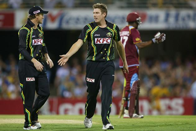 BRISBANE, AUSTRALIA - FEBRUARY 13:  James Faulkner of Australia celebrates with team mates the wicket of Dwayne Bravo of the West Indies during the International Twenty20 match between Australia and the West Indies at The Gabba on February 13, 2013 in Brisbane, Australia.  (Photo by Chris Hyde/Getty Images)