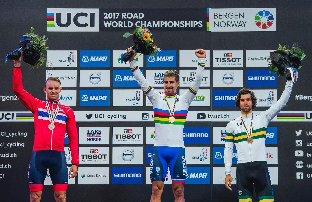Peter Sagan (C), Alexander Kristoff (L) and Michael Matthews pose with their medals after the UCI Cycling Road World Championships in Bergen, on September 24, 2017 (AFP Photo/Jonathan NACKSTRAND)