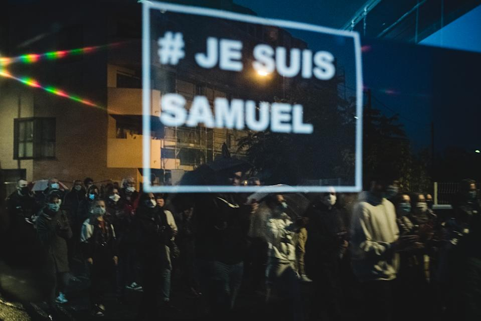 About 6,000 people gathered in front of the Bois d'Aulne College in Conflans Saint-Honorine, a suburb of Paris, on  October 20,  2020, to participate in a white march in honor of Samuel Paty, a history teacher at the college, who was beheaded in an attack on October 16 for showing caricatures of the Prophet Mohammed during a course on freedom of expression. (Photo by Samuel Boivin/NurPhoto via Getty Images)