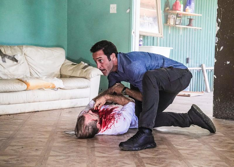 Steve McGarrett (Alex O'Loughlin), top, helps his critically injured friend and colleague Danny Williams (Scott Caan) in the series finale of CBS' 'Hawaii Five-0.'