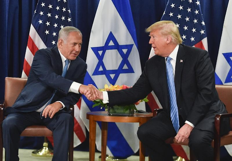 US President Donald Trump shakes hands with Israeli Prime Minister Benjamin Netanyahu on the sidelines of the UN General Assembly in September 2018; the two may meet when the Israeli travels to Washington in late March 2019 (AFP Photo/Nicholas Kamm)