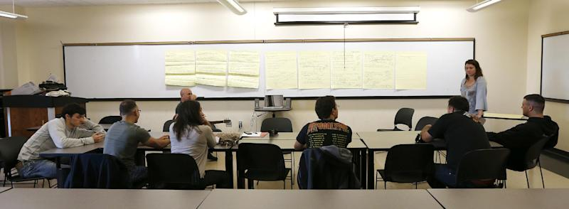 In this Oct. 10, 2012, photo, students participate in a class at Montclair State University in Montclair, N.J. The music class is for service men and women that helps them cope with their life after the military through a program called Voices of Valor. (AP Photo/Julio Cortez)