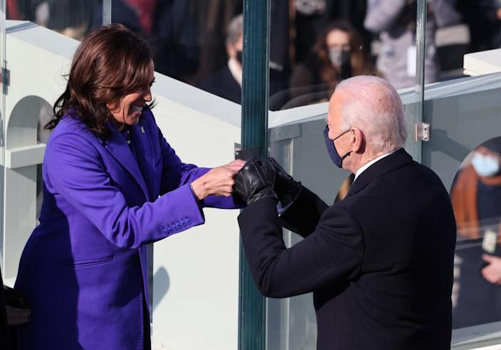 Vice President Kamala Harris bumps fists with President-elect Joe Biden after being sworn in during the inauguration.