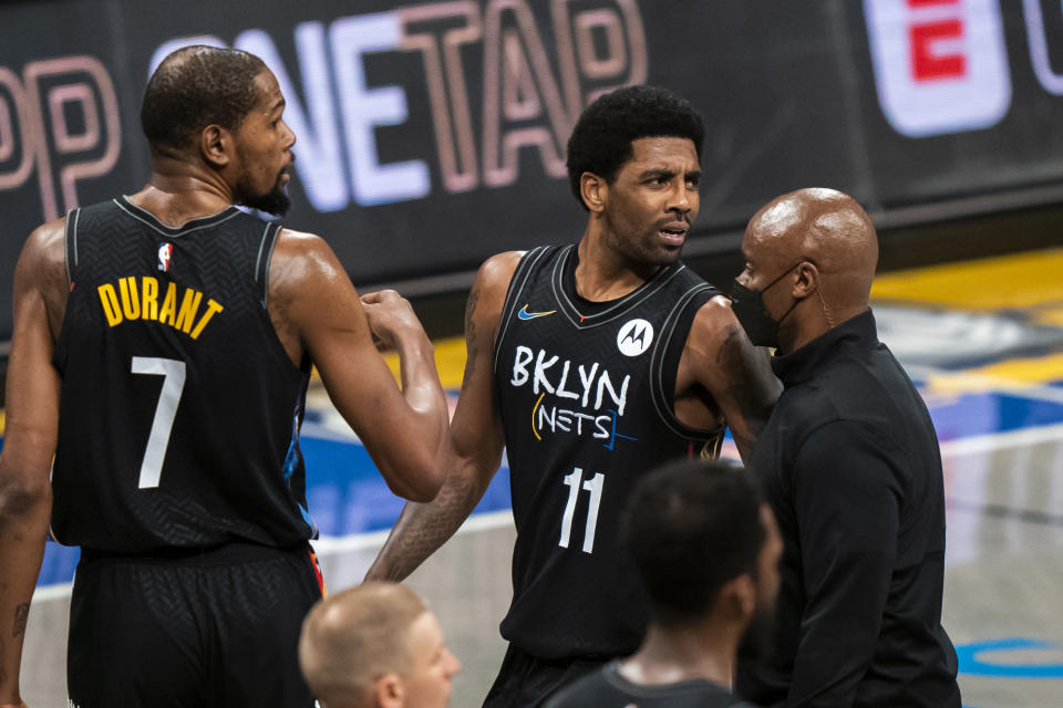 Brooklyn Nets guard Kyrie Irving (11) is ejected after his second technical foul, in the second half of the team's NBA basketball game against the Los Angeles Lakers, Saturday, April 10, 2021, in New York. (AP Photo/Corey Sipkin)