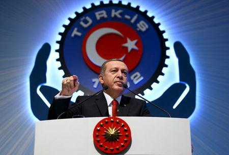 Turkey's President Tayyip Erdogan addresses the audience during a meeting in Ankara