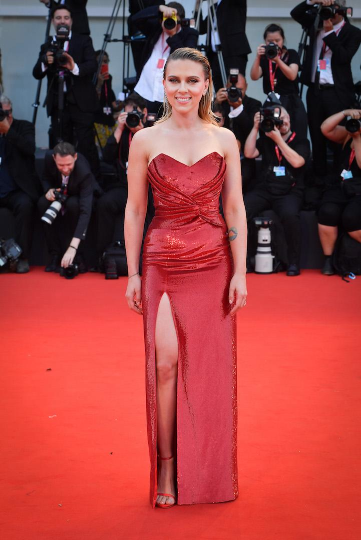 For her second outing at Venice Film Festival, the actress stepped out in a sequinned Celine gown complete with an ultra high thigh split. Slicked back locks and minimal make-up finished the look. <em>[Photo: Getty]</em>