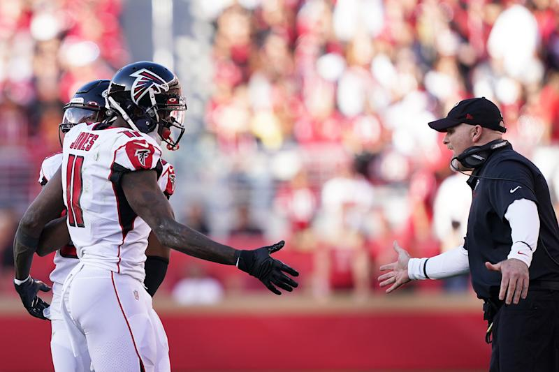 Falcons receiver Julio Jones and coach Dan Quinn celebrate a touchdown by Jones. (Photo by Thearon W. Henderson/Getty Images)