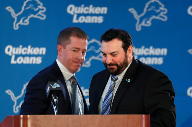 FILE - In this Feb. 7, 2018, file photo, Matt Patricia, right, is introduced as the new head coach of the Detroit Lions by general manager Bob Quinn, left, at their NFL Football training facility in Allen Park, Mich. The Lions would stun everyone if they took a quarterback No. 20 overall Thursday night with many millions invested in Matthew Stafford, or a wide receiver with more than a few options on the team. They could justify bolstering coach Matt Patricias first team at any other position, especially defensive end and offensive guard. (AP Photo/Paul Sancya, File)