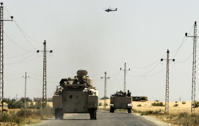 Egyptian soldiers and a military helicopter are deployed in the area of the Rafah crossing in the Sinai Peninsula on May 21, 2013