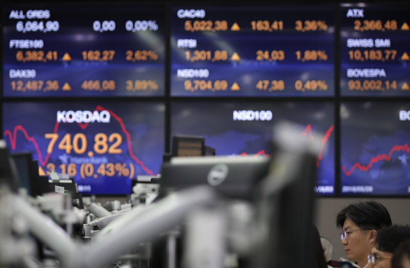Currency traders watch computer monitors at the foreign exchange dealing room in Seoul, South Korea, Thursday, June 4, 2020.  Asian stock markets are mixed after Wall Street rose on better U.S. jobs and manufacturing data than expected. (AP Photo/Lee Jin-man)