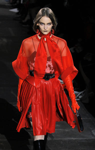 A model wears a creation by Italian fashion designer Riccardo Tisci for Givenchy's fashion house as part of the presentation for Women's Fall-Winter, ready-to-wear 2013 fashion collection, during Paris Fashion week, Sunday, March 4, 2012. (AP Photo/Jacques Brinon)