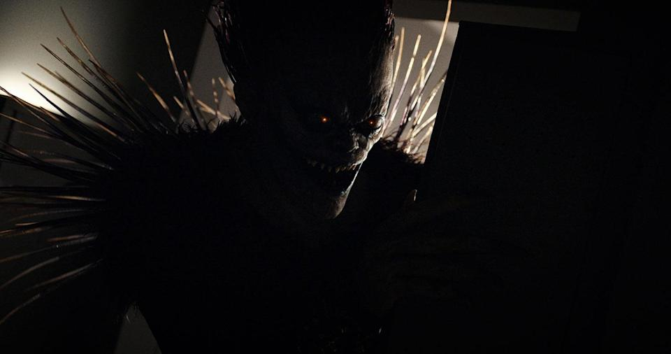 Willem Dafoe voices creepy Shinigami Ryuk who gifts the Death Note to Light, and offers him advice along the way. (Netflix)
