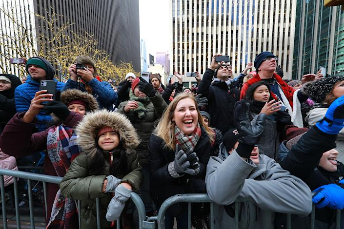 Crowds braved the cold and wind gusts to enjoy the 93rd Macy's Thanksgiving Day Parade in New York. (Photo: Gordon Donovan/Yahoo News)