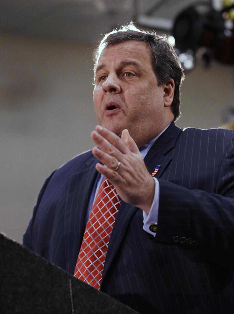 "New Jersey Gov. Chris Christie announces his ""Hurricane Sandy Flood Map Regulations"" Thursday, Jan. 24, 2013, in Seaside Heights, N.J. The town, which was featured in the MTV reality show ""Jersey Shore"" sustained substantial damage to homes and its boardwalk during Superstorm Sandy. (AP Photo/Mel Evans)"