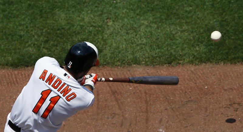 Baltimore Orioles' Robert Andino singles in the third inning of an interleague baseball game against the Washington Nationals in Baltimore, Sunday, June 24, 2012. (AP Photo/Patrick Semansky)