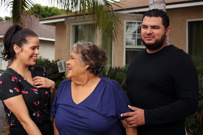 "Maria Guadalupe ""Lupita"" Olague smiles with her twin children, Luz and Raul Arango, at their home in Pico Rivera. <span class=""copyright"">(Dania Maxwell/Los Angeles Times)</span>"